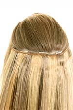 затылок сформирован при помощи трех накладных прядей, увеличилась длина и объем волос